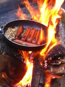 Mmmm. Onions and bratwurst over a campfire.